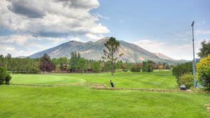 Ground view of golf course at Continental Country Club in Flagstaff, AZ with view of mountain.