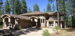 Exterior of Forest Highland's 2511 Lindberg Spring Flagstaff AZ 86005 golf home.